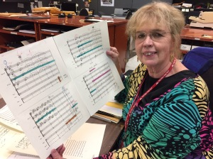 Mary Judge, CSO librarian, with Erich Kunzel's score to Fanfare for the Common Man